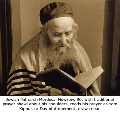 Jewish Patriarch Mordecai Newzow, 96, with traditional prayer shawl about his shoulders, reads his prayer as Yom Kippur, Day of Atonement, draws near.